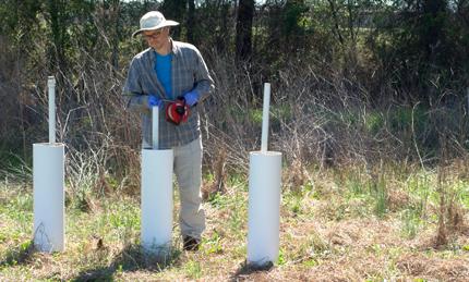 Measuring well depth in riparian buffer, North Carolina.